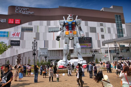 TOKYO, JAPAN - MAY 11, 2012: People visit Gundam robot replica in Odaiba,Tokyo. The sculpture is 18m tall and is the tallest replica of famous anime franchise robot, Gundam.