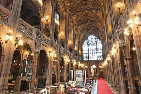 MANCHESTER, UK - APRIL 22, 2013: Interior view of John Rylands Library in Manchester, UK. The library opened to public in 1900 and is a Grade I Listed building. Editorial