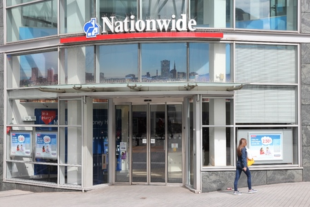 nationwide: BIRMINGHAM, UK - APRIL 19, 2013: Person walks by Nationwide Building Society branch in Birmingham, UK. Nationwide Building Society Group has 193.3 billion GBP in assets (2013).