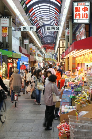 food shop: OSAKA, JAPAN - APRIL 25, 2012: Shoppers visit Nipponbashi Kuromon market in Osaka, Japan. According to Tripadvisor, it is currently among best 3 shopping places in Osaka.