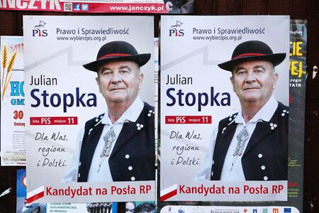 senate elections: CHOCHOLOW, POLAND - OCTOBER 4, 2015: Candidate posters for 2015 Parliamentary Election in Poland. PiS, Law and Justice party is a right wing election option.