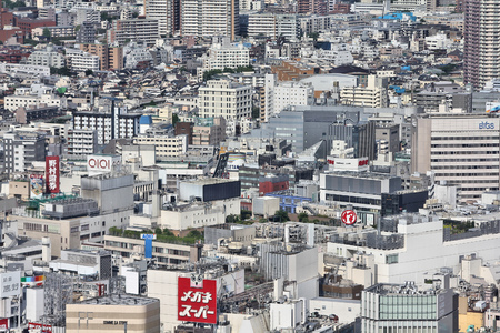 TOKYO, JAPAN - MAY 11, 2012: City view of Shinjuku ward, Tokyo, Japan. Tokyo is the capital city of Japan and the most populous metropolitan area in the world with almost 36 million people.