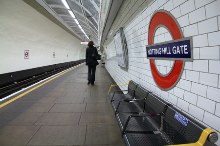 notting hill: LONDON, UK - MAY 14, 2012: Person waits at Notting Hill Gate underground station in London. London Underground is the 11th busiest metro system worldwide with 1.1 billion annual rides.