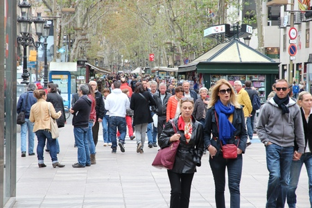rambla: BARCELONA, SPAIN - NOVEMBER 6, 2012: People walk famous Rambla street in Barcelona, Spain. According to Mastercard, Barcelona is the 15th most visited city worldwide (7.5m in 2012). Editorial