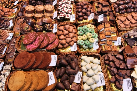 Sweets store at Boqueria market place in Barcelona, Spain. Assorted chocolate candy shop.