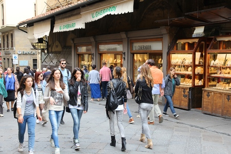 visitors area: FLORENCE, ITALY - MAY 1, 2015: People visit Old Town in Florence, Italy. Italy is visited by 47.7 million tourists a year (2013). Editorial