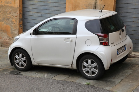 iq: SIENA, ITALY - MAY 3, 2015: Toyota IQ city car parked in Siena, Italy. IQ is in production since 2008. Toyota is the 11th-largest company in the world by revenue.