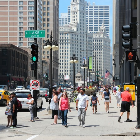 michigan avenue: CHICAGO, UNITED STATES - JUNE 27, 2013: People walk downtown in Chicago. Chicago is the 3rd most populous US city with 2.7 million residents (8.7 million in its urban area). Editorial