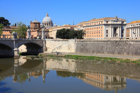 tevere: Rome, Italy. View of River Tevere and Vatican in background (Saint Peters Basilica). Stock Photo