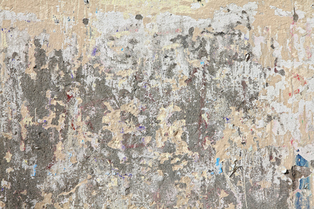 urban decline: Grungy wall with peeling paint. Grungy background texture.