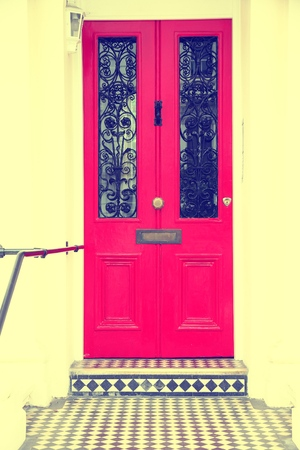victorian architecture: London, United Kingdom - typical colorful Victorian architecture door. Retro photo filtered style.