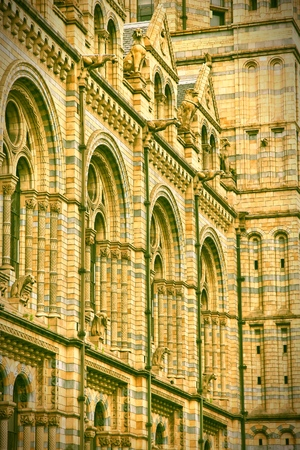 history building: London, United Kingdom - architecture of Natural History Museum. Retro photo filtered style.