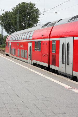 db: BOCHUM, GERMANY - JULY 16, 2012: DB Regio train of Deutsche Bahn in Bochum, Germany. DB employs 276 thousand people and had 34.4 billion EUR revenue in 2010.