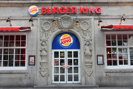 famous industries: DORTMUND, GERMANY - JULY 15, 2012: Burger King restaurant in Dortmund, Germany. As of 2013 the fast food chain had over 13,000 outlets in 79 countries.