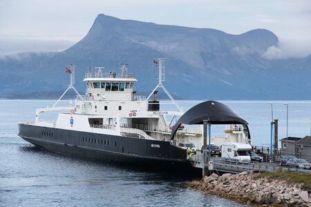 disembark: BOGNES, NORWAY - JULY 25, 2015: People disembark Torghatten Melshorn ferry ship in Bognes, Norway. Public transport by ferry transports more than 8 million passengers annually. Editorial