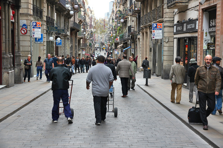 carrer: BARCELONA, SPAIN - NOVEMBER 6, 2012: People walk Carrer de Ferran street in Barcelona. According to Mastercard, Barcelona is the 15th most visited city worldwide (7.5m in 2012).