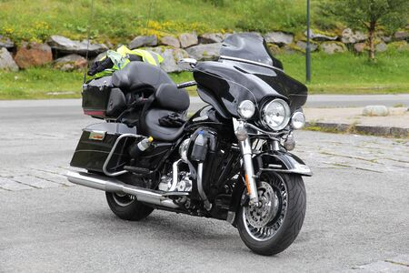 touring: NORDLAND, NORWAY - JULY 25, 2015: Harley-Davidson motorcycle parked in Nordland, Norway. The American company manufactures motorcycles since 1903. Editorial