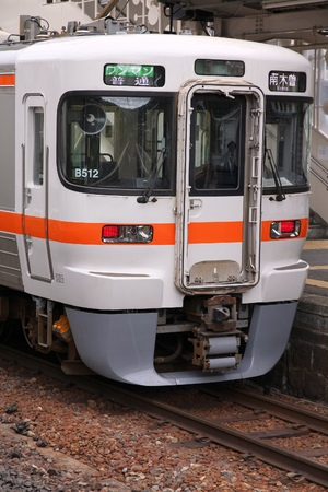 net income: NAGISO, JAPAN - MAY 2, 2012: Central Japan Railway Company electric train of 313 series stands at Nagiso station. JR Central had 134 billion JPY in net income for 2011.