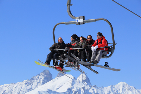 ski runs: VALLOIRE, FRANCE - MARCH 23, 2015: Skiers go up the lift in Galibier-Thabor station in France. The station is located in Valmeinier and Valloire and has 150km of ski runs.