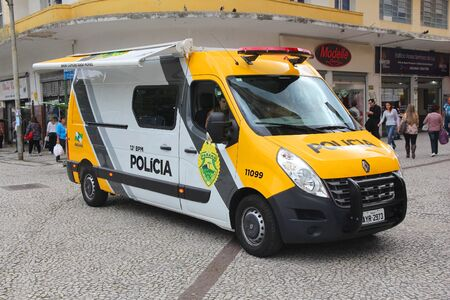 law of brazil: CURITIBA, BRAZIL - OCTOBER 7, 2014: Police officers patrol Curitiba, Brazil. 450,000 officers of Military Police in Brazil serve as deterrent for crime, they dont engage in detective work.
