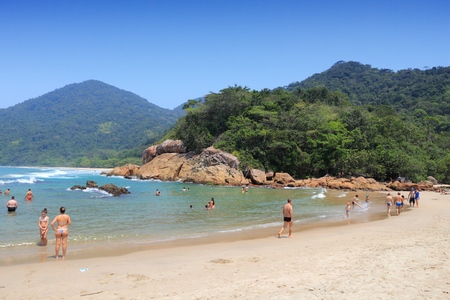 brazil beach swimsuit: PARATY, BRAZIL - OCTOBER 16, 2014: People visit Trindade beach in Paraty, state of Rio de Janeiro in Brazil. Brazil had 5.17 million visitors in 2012. Editorial