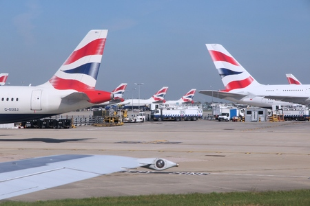LONDON, UK - APRIL 16, 2014: British Airways Airbus A320s and A380 at London Heathrow airport. BA operates fleet of 283 aircraft (largest in the UK) and is largest operator of 747 with 55 aircraft (2014).