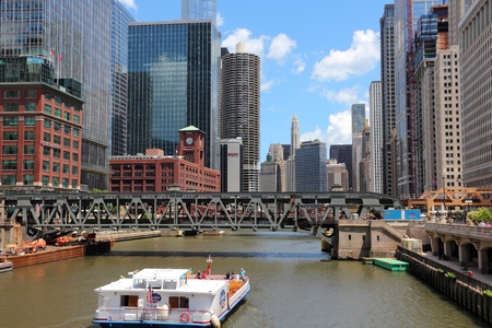 chicago city: CHICAGO, USA - JUNE 28, 2013: Downtown view with Chicago River. Chicago is the 3rd most populous US city with 2.7 million residents (8.7 million in its urban area). Editorial
