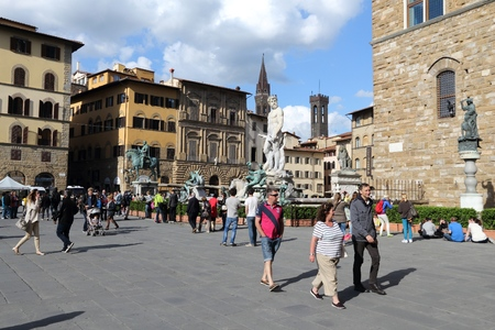 old town square: FLORENCE, ITALY - APRIL 30, 2015: People visit Old Town square Piazza della Signoria in Florence, Italy. Italy is visited by 47.7 million tourists a year (2013).