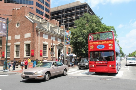 administered: PHILADELPHIA, USA - JUNE 11, 2013: People right sightseeing bus in Independence National Historical Park in Philadelphia. The Park was designated in 1948 and is administered by NPS.