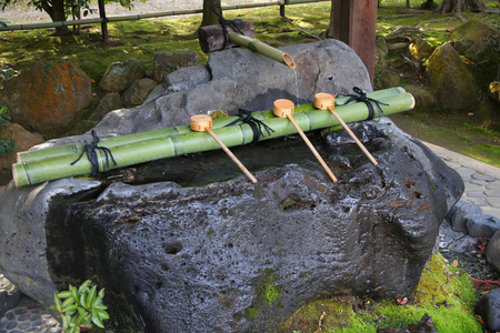 ladles: Japan culture - purification fountain with wooden ladles at a Buddhist temple (Ryoanji) in Kyoto.