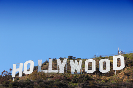hollywood: LOS ANGELES, USA - APRIL 5, 2014: Hollywood Sign in Los Angeles. The sign was originally created in 1923 and is a Los Angeles Historic-Cultural Monument.