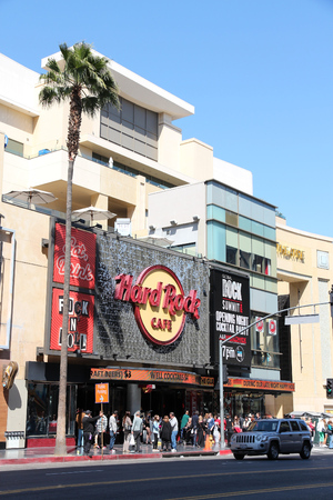 hard rock cafe: LOS ANGELES, USA - APRIL 5, 2014: People visit Hard Rock Cafe in Hollywood. As of 2015 there are 191 Hard Rock locations around the world. Editorial
