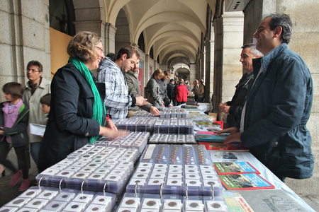 MADRID, SPAIN - OCTOBER 21, 2012: Shoppers visit Sunday Collectible Market in Plaza Mayor, Madrid. The weekly market is one of most popular of its kind in Europe.