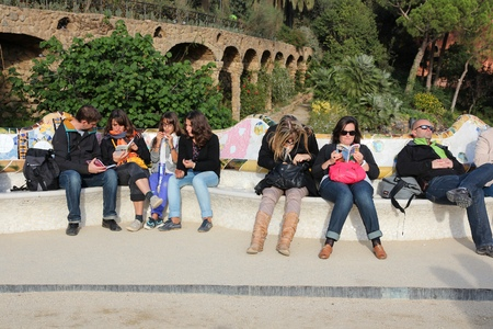 trencadis: BARCELONA, SPAIN - NOVEMBER 6, 2012: People visit Park Guell in Barcelona, Spain. It was built in 1900-14 and  is part of the UNESCO World Heritage Site Works of Antoni Gaudi.