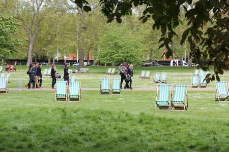 st jamess: LONDON, UK - MAY 16, 2012: People walk in St. Jamess Park in London. With more than 8.4 million people, London is the most populous municipality of the EU. Editorial