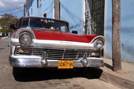 capita: SANCTI SPIRITUS, CUBA - FEBRUARY 7, 2011: Classic yank tank oldtimer car in Sancti Spiritus. Cuba has one of lowest vehicle per capita rates in the world (38 per 1000 citizens in 2008).
