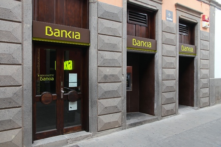 bank branch: ARUCAS, SPAIN - NOVEMBER 29, 2015: Bankia bank branch in Arucas, Spain. Bankia is a Spanish bank conglomerate, the fourth largest bank of Spain with 12 million customers (2012).