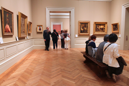 museum visit: NEW YORK, USA - JUNE 7, 2013: People visit Metropolitan Museum of Art in New York. With 5.2m visitors in 2010 it is the most visited museum in the USA.