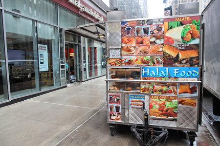 accordance: NEW YORK, USA - JUNE 10, 2013: Halal food cart in New York. Halal food is prepared in accordance with Islamic law.