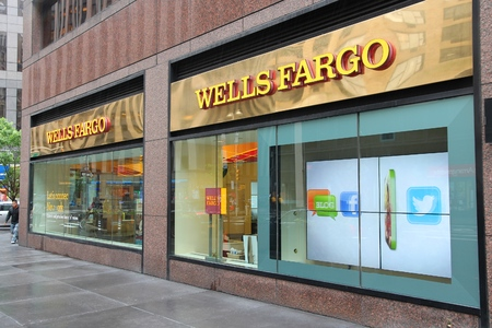 bank branch: NEW YORK, USA - JUNE 10, 2013: People walk by Wells Fargo Bank branch in New York. Wells Fargo was the 23rd largest company in the United States in 2011 (by revenues).