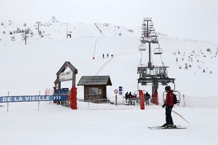 ski runs: VALLOIRE, FRANCE - MARCH 27, 2015: Skiers go up the lift in Galibier-Thabor station in France. The station is located in Valmeinier and Valloire and has 150km of ski runs. Editorial