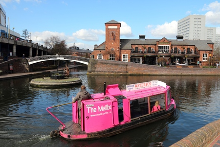 navigable: BIRMINGHAM, UK - APRIL 19: People ride a boat in the canal network of Birmingham, UK. There are at least 3,500km of navigable canals, rivers and docks in the UK.
