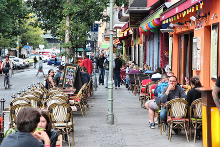 visitors area: BERLIN, GERMANY - AUGUST 26, 2014: People dine out in Wrangelkiez area of Kreuzberg district in Berlin. 11.3 million guests visited Berlin in 2014.