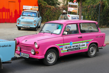 infamous: BERLIN, GERMANY - AUGUST 25, 2014: Colorful Trabant 601 cars parked in Berlin. 3,096,099 Trabant cars were produced despite their infamous inefficiency and outdated technology.