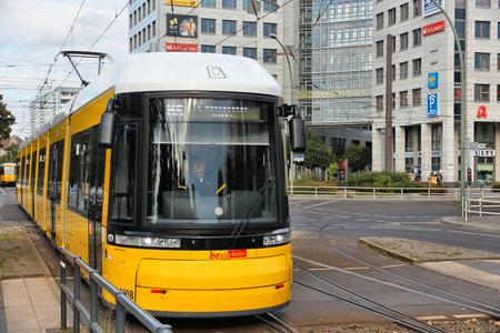 trams: BERLIN, GERMANY - AUGUST 25, 2014: People ride tram in Berlin. Berlin trams carry some 174 million annual passengers.