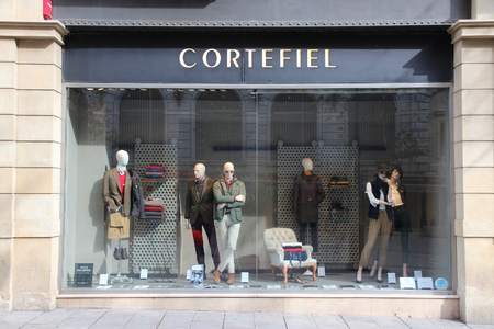 famous industries: BARCELONA, SPAIN - NOVEMBER 6, 2012: Cortefiel fashion shop in Barcelona, Spain. Cortefiel group is the 2nd largest apparel retailer in Spain.