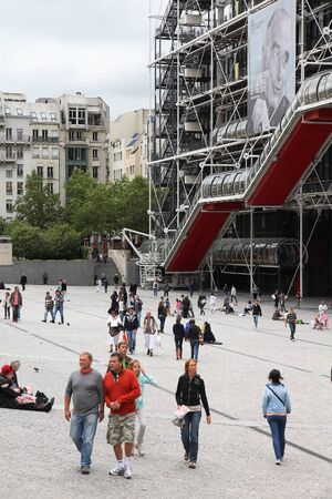 postmodern: PARIS, FRANCE - JULY 20, 2011: People visit Place Georges Pompidou in Paris, France. The postmodern structure completed in 1977 is one of most recognizable landmarks in Paris.