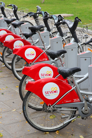 shared sharing: SEVILLE, SPAIN - NOVEMBER 3, 2012: Sevici bicycle sharing station in Seville. The system has 260 rental stations and 3.200 bicycles. It is operated by advertising company JCDecaux. Editorial
