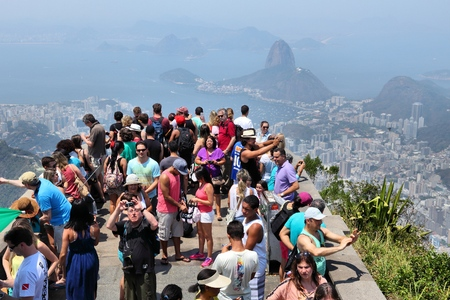 overcrowded: RIO DE JANEIRO, BRAZIL - OCTOBER 19, 2014: Overcrowded scenic overlook next to Christ the Redeemer in Rio de Janeiro. In 2013 1.6 million international tourists visited Rio.