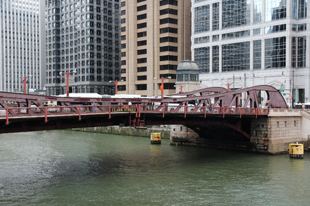movable: CHICAGO, USA - JUNE 26, 2013: People walk the Clark Street bridge in Chicago. It is one of Chicagos 37 operable movable bridges. Editorial
